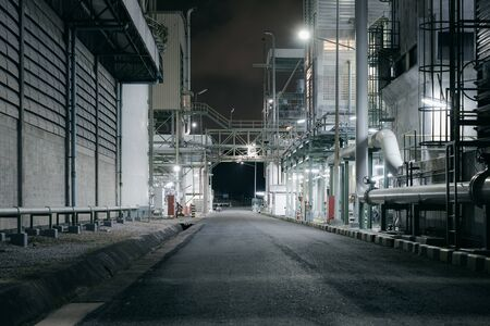 Factory building and road of industrial plant at night