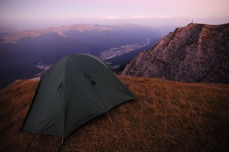 cliff edge: Tent on mountain cliff edge in the evening
