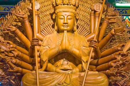 Wooden Buddha. photo