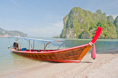 longtail: Longtail boat on tropical beach.