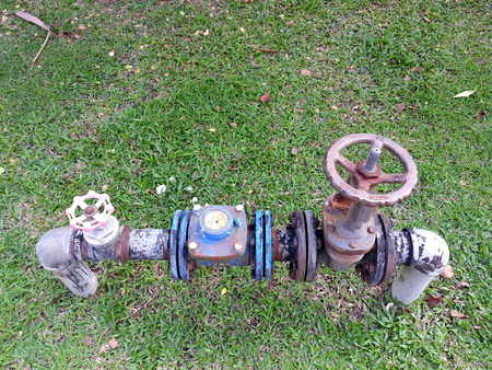 articulation: big and small water valve on the lawn Stock Photo