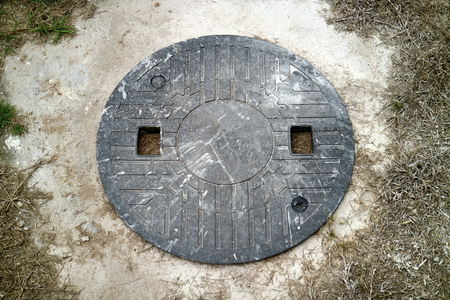 sewer: plastic sewer lid was stained with white painting acrylic Stock Photo