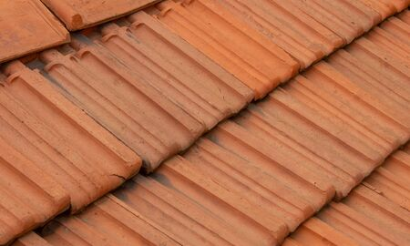 Roof top tiles arranged in interlocked position on a residential house Stock fotó - 134795050