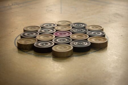 Coins arranged in order for carrom board game. Multiplayer board game with good fun time.