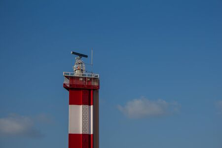 View of lighthouse near marina beach against blue sky background, Chennai, India