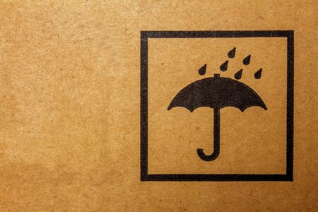 Packaging sign usually found on cargo packages. It means to keep the package away from rain or damp conditions.