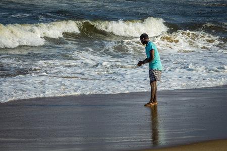 Kovalam, Tamil Nadu, India - February 04 2021: Fisherman catching crabs in the shore along the Kovalam beach, Chennai, India. Redakční