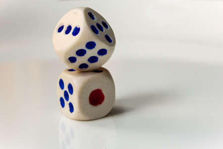 Close view of the dices used in play. Rolling out the dices.