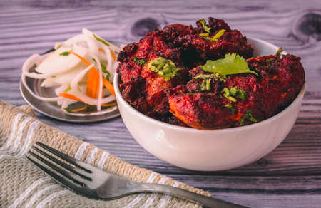 Deep fired chicken known as chicken 65 in south india. Spicy fried chicken with relish Reklamní fotografie