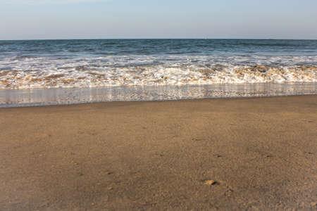 Beautiful view of waves along the beach in coastal town of Mahabalipuram, India