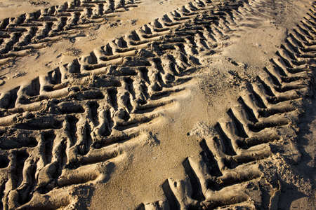 Tractor Tire marks over the beach sand in Mahabalipuram. Tyre impression of a vehicle. Reklamní fotografie
