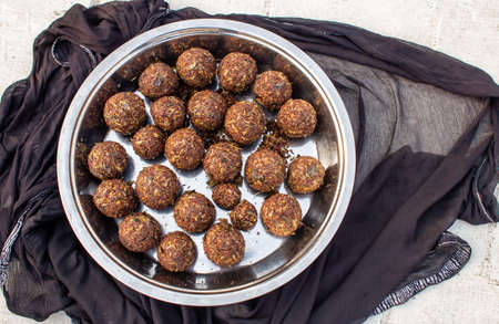 Round balls of Vadouvan (occasionally spelled vaudouvan) is a ready-to-use blend of spices used in cooking. Sun dried blend of spices