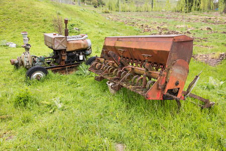 farm equipment: Abandoned farm equipment in the countryside