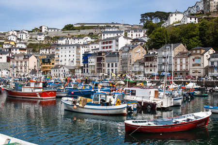 Fishing harbour with trawlers Editorial