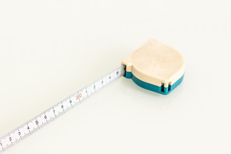 long and short scales: Measuring tape on white background Stock Photo