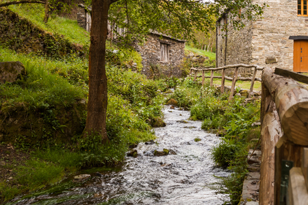 Mountain village by the river Stock Photo