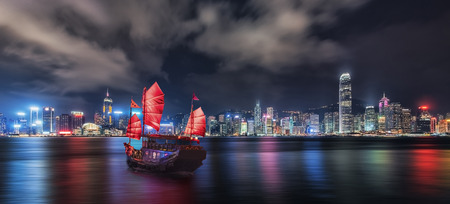 Tourist junk crossing the victoria Harbor in Hong Kong