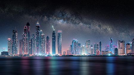 Dubai city under the milky way