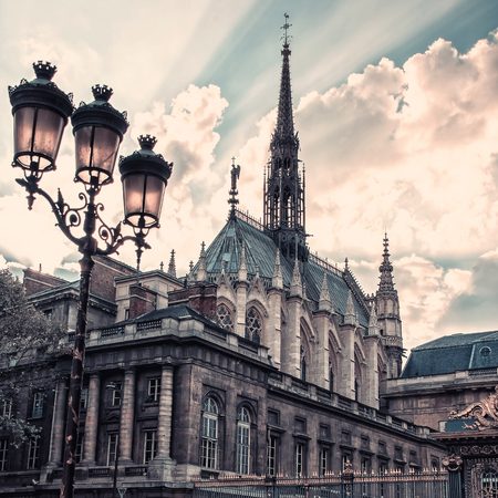 Sainte Chapelle and viewed from the entrance of the court in Paris