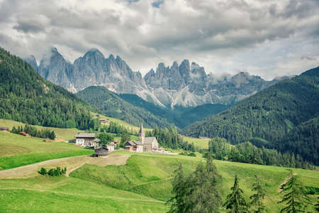 Santa Maddalena village with beautiful Dolomites mountains in the background, Val di Funes valley, Italy 写真素材