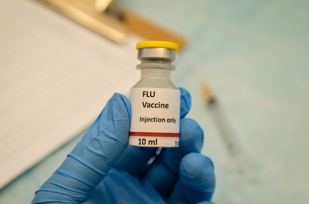 Flu vaccine vial. The label is created for photography purpose only Imagens - 93833806