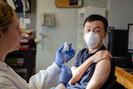 Chinese male receiving coronavirus vaccine