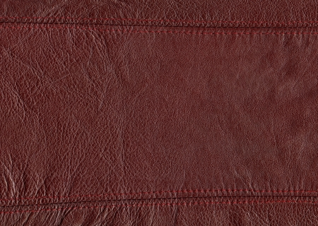 part of leather vest with seam on the top and bottom