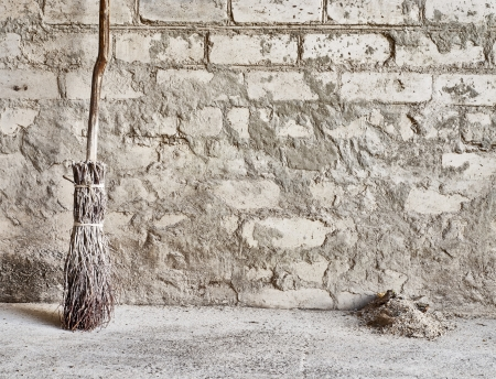 grunge wall and wooden broom background  Stock Photo - 16719868