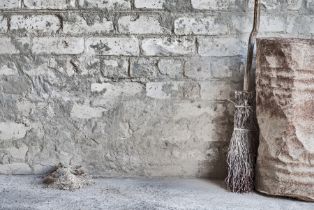 grunge wall, wooden broom and old barrel background Stock Photo - 16719696