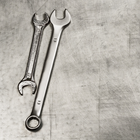 Spanners, wrenches on a metal plate