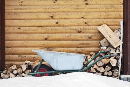 wheelbarrow near the fire woods background