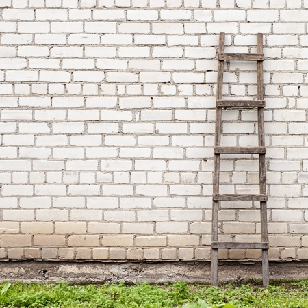 weathered brick wall background, ladder on the right side Standard-Bild