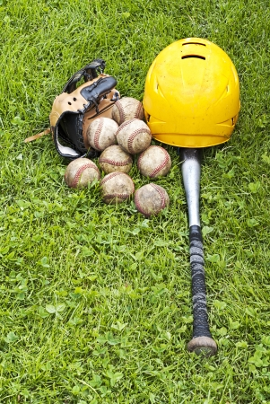 baseball equipment on the grass photo