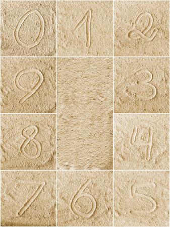 Numbers written on a sand (from 1 to 0) photo