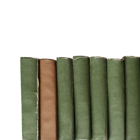 histories: brown and green vintage old books isolated on white