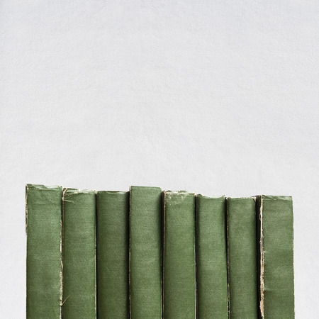 histories: green vintage old books isolated on white