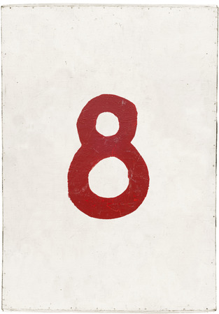 number eight on white plywood board, isolated on white background photo
