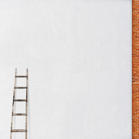 weathered stucco wall, red brick frame with a wooden ladder background photo