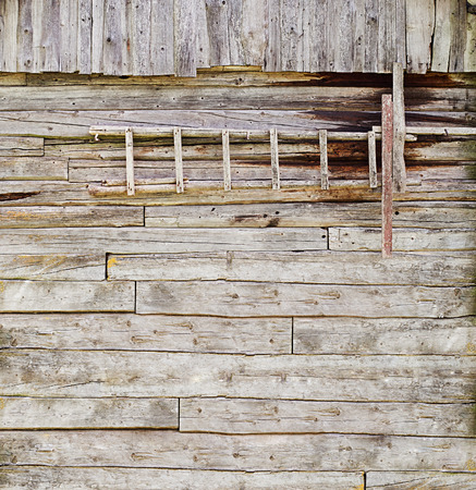 wooden ladder on the plank wall background photo