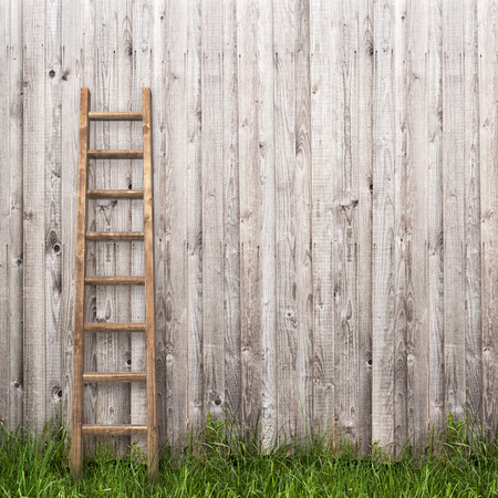 ladder: grey plank wall with wooden ladder background