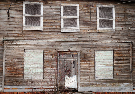 boarded up: abandoned wooden house with boarded up windows Stock Photo