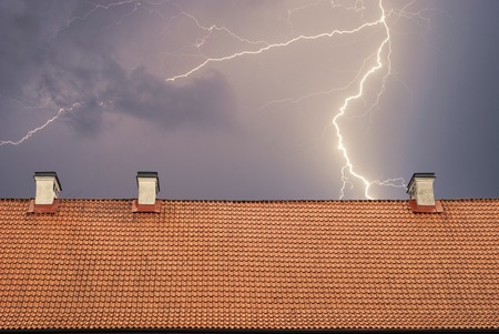 roof top: Thunderstorm with lightening, top of the roof at night