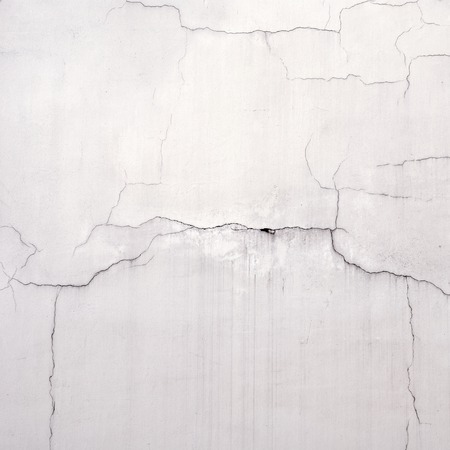 cracked wall: weathered grunge  cracked white stucco wall background Stock Photo