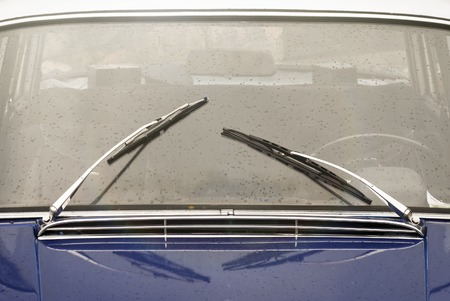 windscreen wiper: window with wipers of blue vintage car Stock Photo