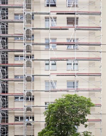 restoration: restoration facade of tall house, scaffolding construction