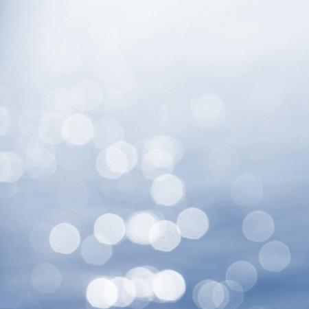 Bokeh de l'eau de fond avec les fuites de lumi�re et le grain Banque d'images
