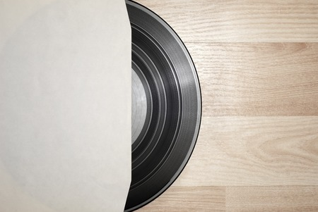 record cover: Vinyl record with cover on wooden table background Stock Photo