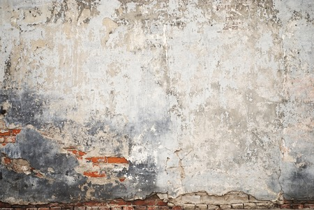 abandoned grunge cracked brick stucco wall background 写真素材