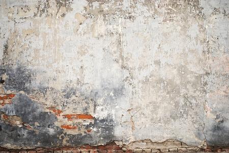 abandoned grunge cracked brick stucco wall background Foto de archivo