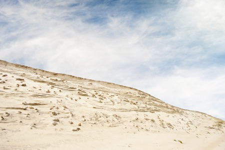 lopsided: Big dunes and blue cloudy sky background